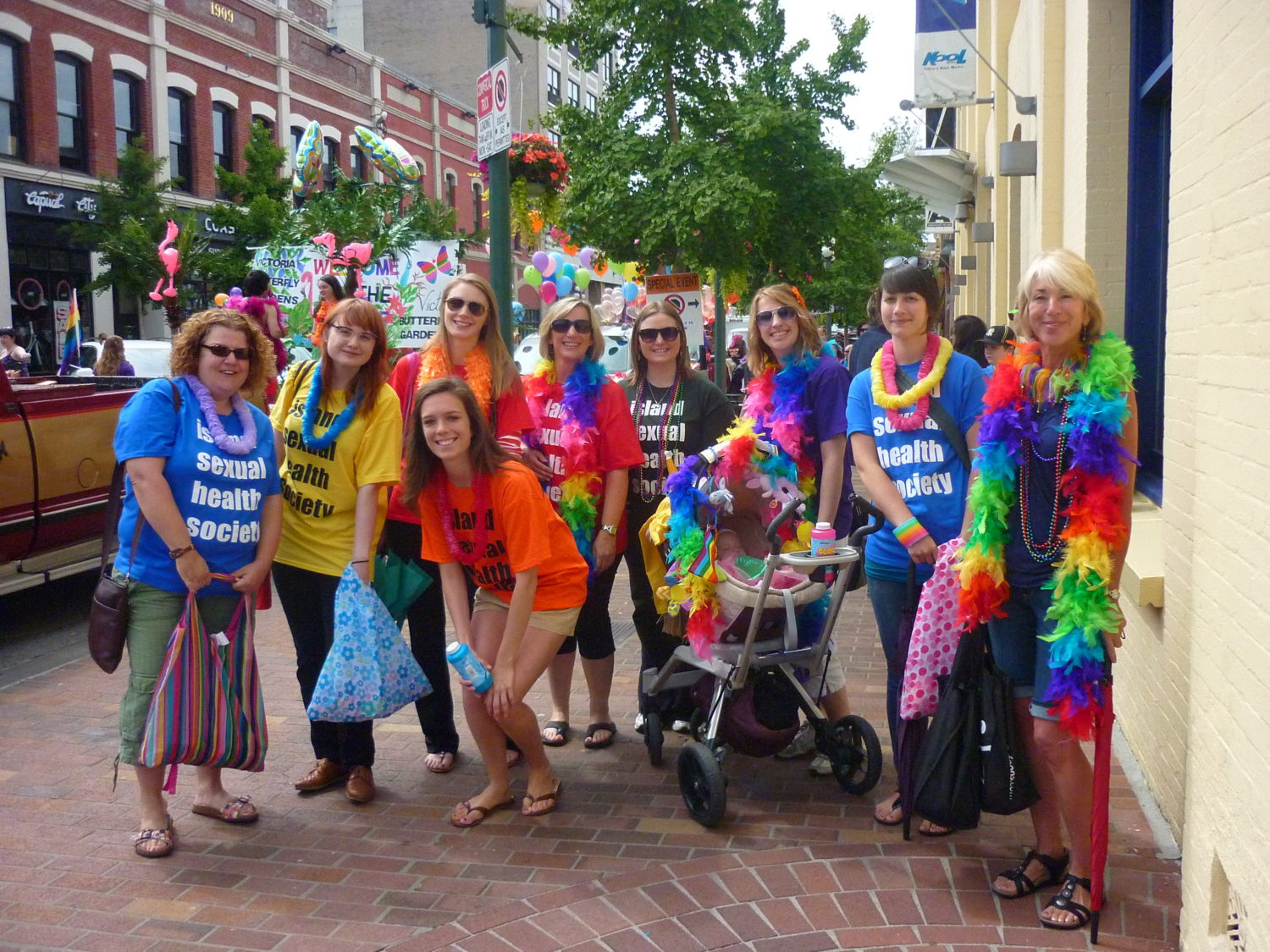 ISHS staff and volunteers dressed in rainbow colours getting ready for Victoria Pride Parade 2011