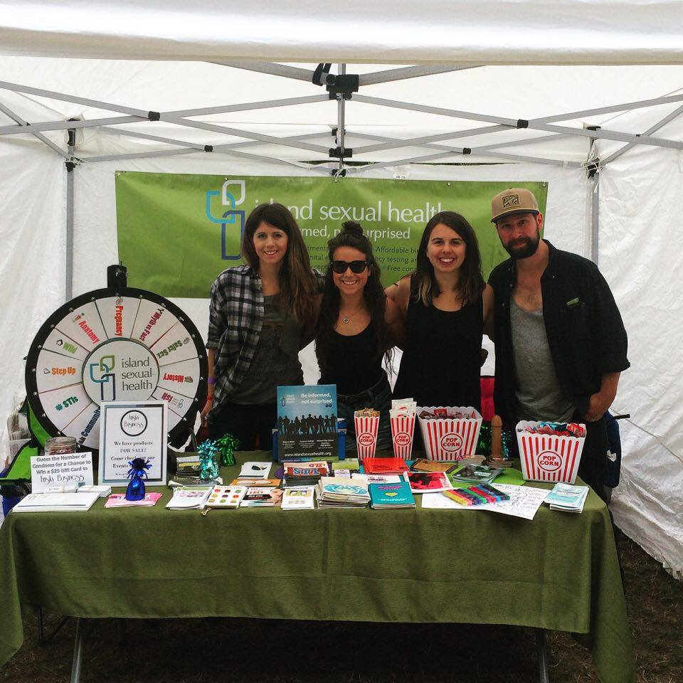 Our awesome events team running our booth at Rock of the Woods music festival!